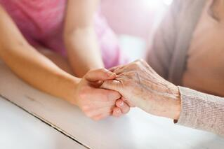LTCI_Grandmother_holding_hands_with_granddaughter.jpeg