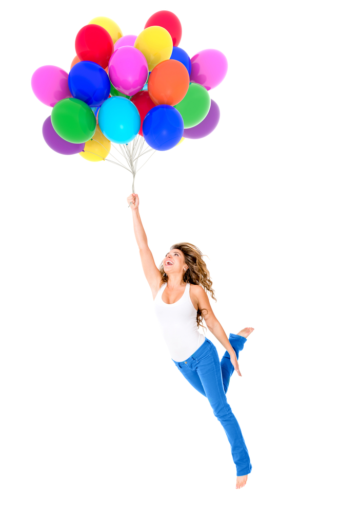 Happy woman holding balloons - isolated over a white background