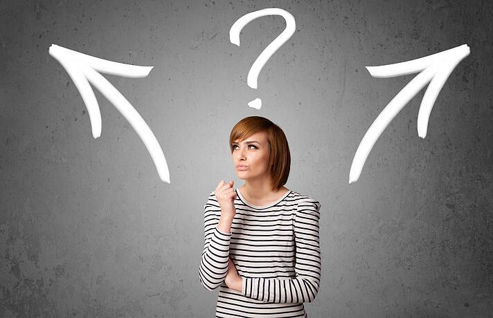 Pretty young woman making a decision with arrows and question mark above her head.jpeg