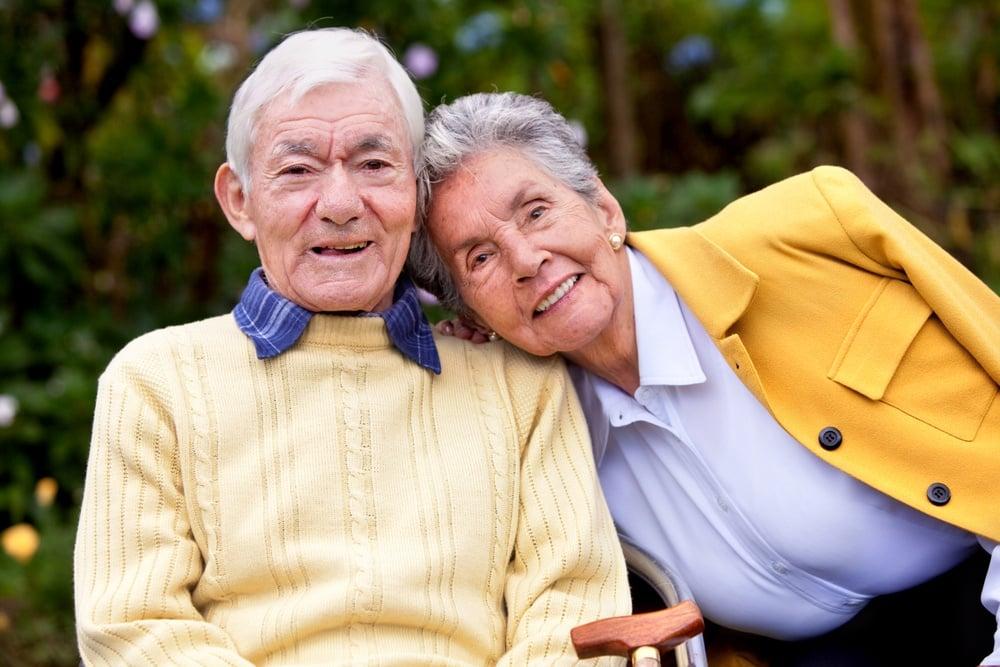 portrait of a loving elderly couple outdoors.jpeg