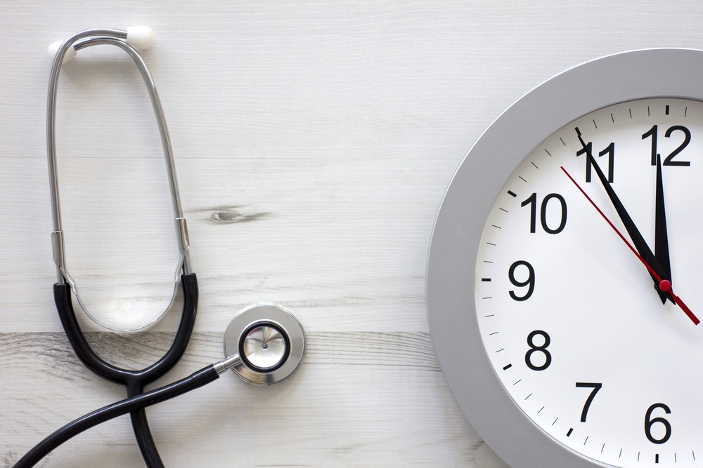 Concept showing doctors stethoscope and a clock face simulating an appointment.jpeg